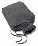 Hot water bottle with soft grey fabric cover