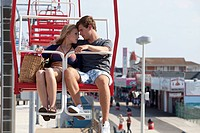 Teenage couple on ferris wheel
