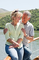 Senior couple enjoying a boat holiday (thumbnail)