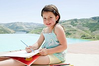 Young girl with coloring pencils and coloring book
