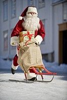 Santa Claus on a sled with a sack full of presents