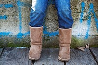 Kid wearing Australian boots. Detail