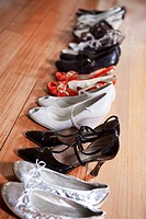 Row of waman shoes on hardwood floor