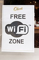 A sign advertising Free Wifi zone at Olive's cafe in Norwich , Norfolk , England , Great Britain , Uk