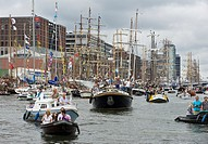 Busy boat traffic on the Ij river, Sail 2010 boat parade, Amsterdam, the Netherlands
