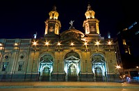 The ornate Classical and Baroque facade of a Christian church at night