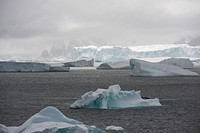 Icebergs off the coast of Detaille Island, from 1956 to 1959 it was home to Station W of the British Antarctic Survey.