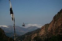 Corsican Park service helicopter servicing refuges with supplies.