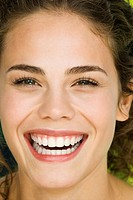 Portrait of a young woman laughing, close_up