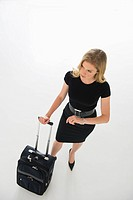 Business woman with travel case