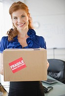 Businesswoman holding a package