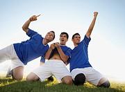 Three happy soccer players