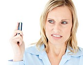 Angry buisinesswoman holding a cellphone looking to the side against white background