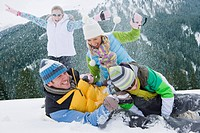 Family having snowball fight in snow