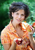 young brunette woman eating apple