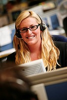 Call centre operator, using a headset to answer the telephone  Service centre