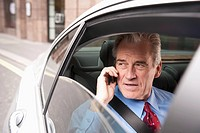 Businessman Sat in Rear of Car