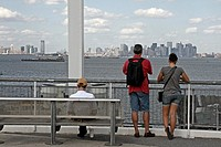 People watching Manhattan, Staten Island, New York, USA.