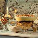 Whole glass bowl of Christmas trifle on a tabletop