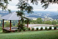 Garden with hot tub and swimming pool and a view over countryside