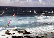 Group of windsurfers offshore in waves