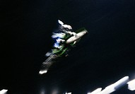 Blurred man jumping a dirt bike