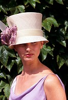 Fashionable woman in dress clothes at horse racing meeting
