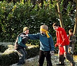 Portrait of children playing blindman's buff in the garden