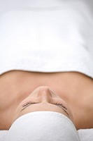 Close up of young woman lying on back and relaxing after beauty treatment
