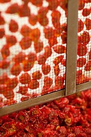 Close up of sun dried tomatoes on a drying mesh