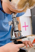 Schoolboy looking in a microscope
