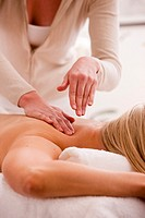 Woman lying on stomach receiving a massage