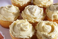 Lemon Cupcakes with Yellow Icing and Sugar Crystals, On White Plate