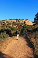 Hiker on Echo Canyon Trail - Enchanted Rock SNA, Texas