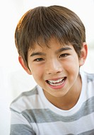 Close up of smiling mixed race boy