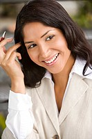 Close up of smiling Hispanic businesswoman