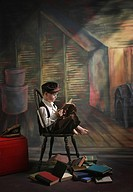 victoria, british columbia, canada, a boy posed reading old books