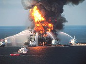 Deepwater Horizon oil rig fire, Gulf of Mexico. Fire boats dousing the flames of the offshore oil rig Deepwater Horizon on 21st April 2010. The fire b...