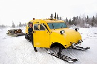 man with snow sled in wapusk national park, churchill, manitoba, canada