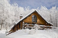 log house in the winter, quebec, canada