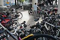 BICYCLE PARKING LOT NEAR THE MAIN TRAIN STATION, AMSTERDAM, NETHERLANDS