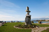 Inukshuk at English Bay Beach, Vancouver British Colombia, facing west on a summer afternoon
