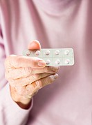 Aspirin_based cardiovascular pills. Elderly woman holding a packet of pills. These are 100 milligram ASS Cardio pills from the Swiss company Spirig Ph...