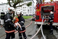 FIREFIGHTERS RESCUING A CHILD FROM AN APARTMENT FIRE IN A SUBSIDIZED HOUSING BUILDING, LAVAL, MAYENNE 53, FRANCE