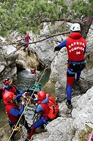 EVACUATION OF A VICTIM BY THE SPECIALIZED TEAM OF THE FIREMEN OF THE SDIS IN THE ALPES_MARITIMES, RESCUE OF A CANYONING ACCIDENT, CANYON OF THE VALLON...