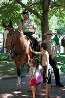 Boston, Massachusetts - Children pet a police horse on Boston Common