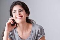 Young woman talking on the phone happily