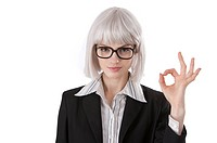 Young businesswoman giving OK sign