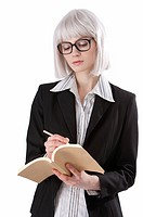 Young businesswoman writing on a notebook