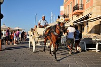 Horse carriage galloping at the old port of Chania, Crete island, Greece